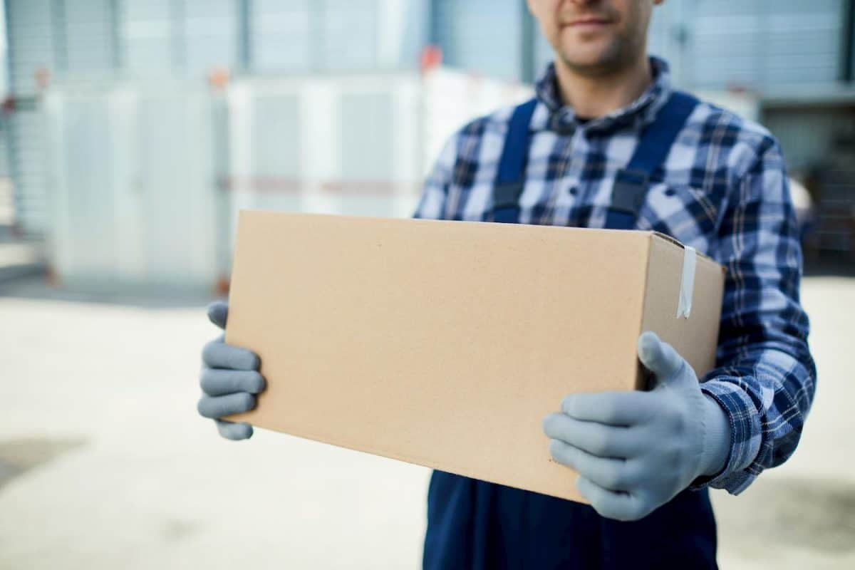 photo of a mover holding a box
